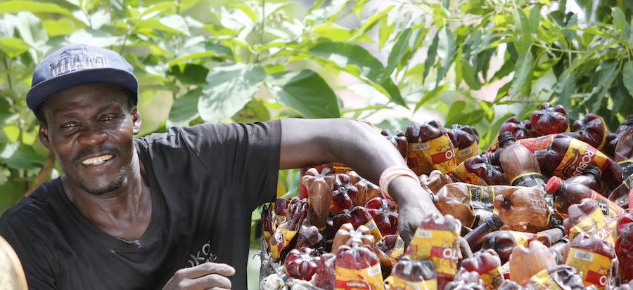 A Haitian man collecting ocean-bound plastic