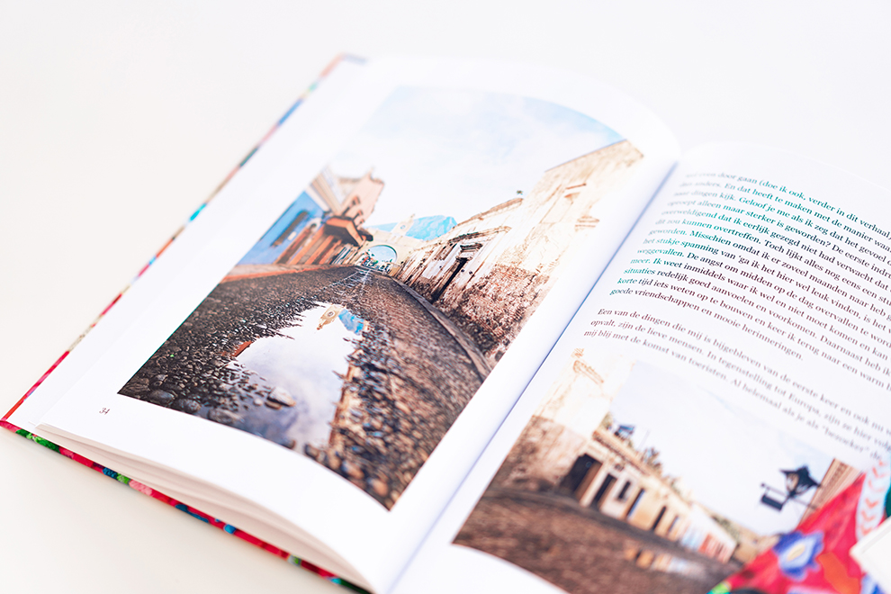 Printed hardcover book with photos and texts