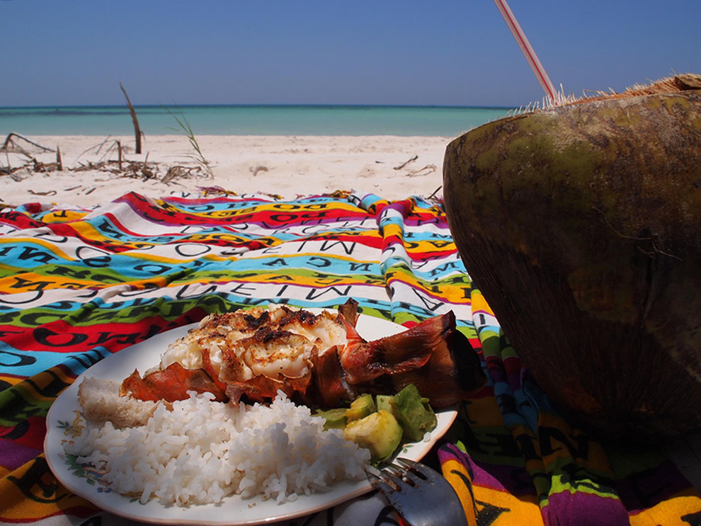 Eating local food on the beach in Cuba