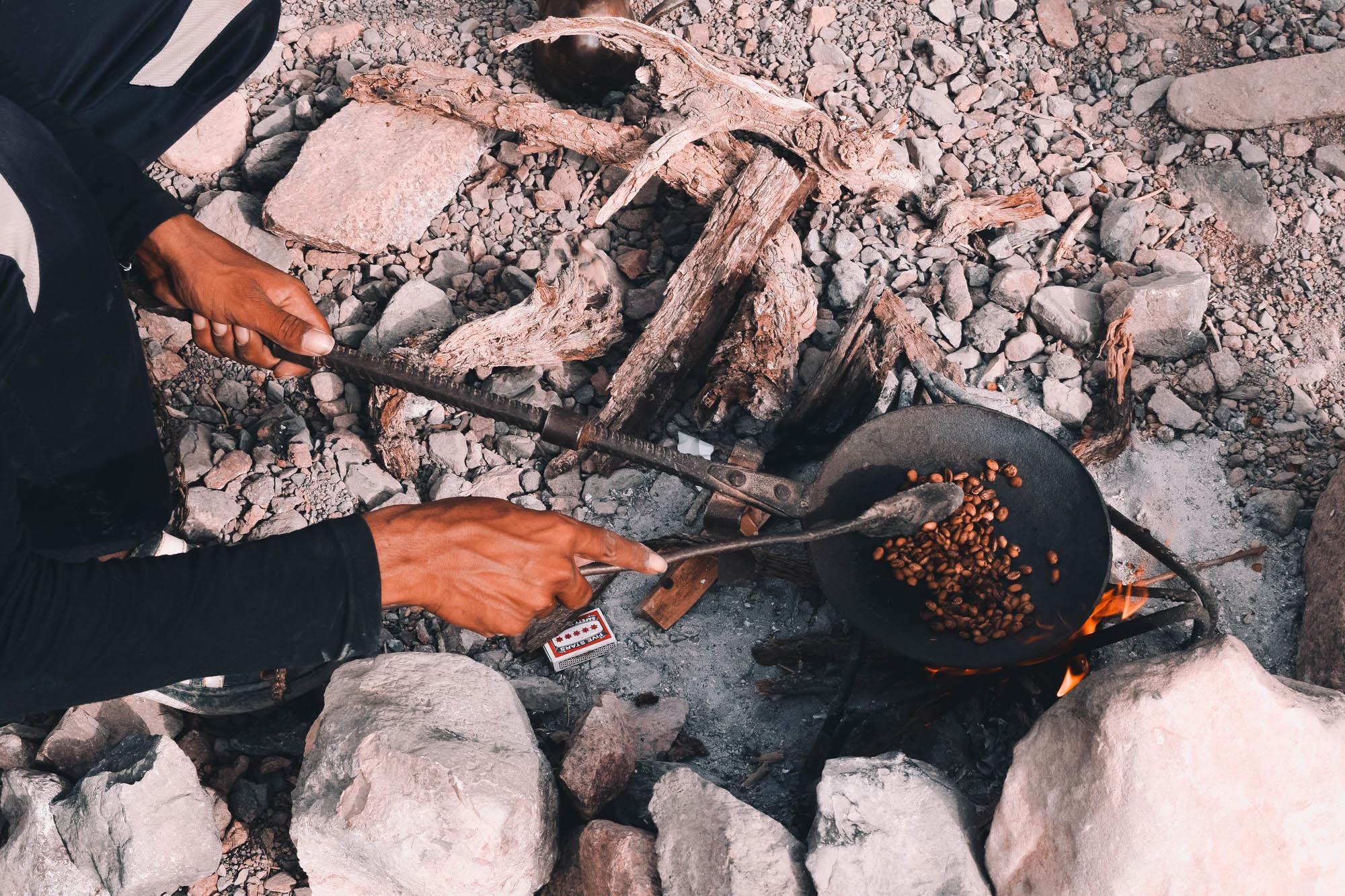 Coffee beans are roasted over the fire in Jordan