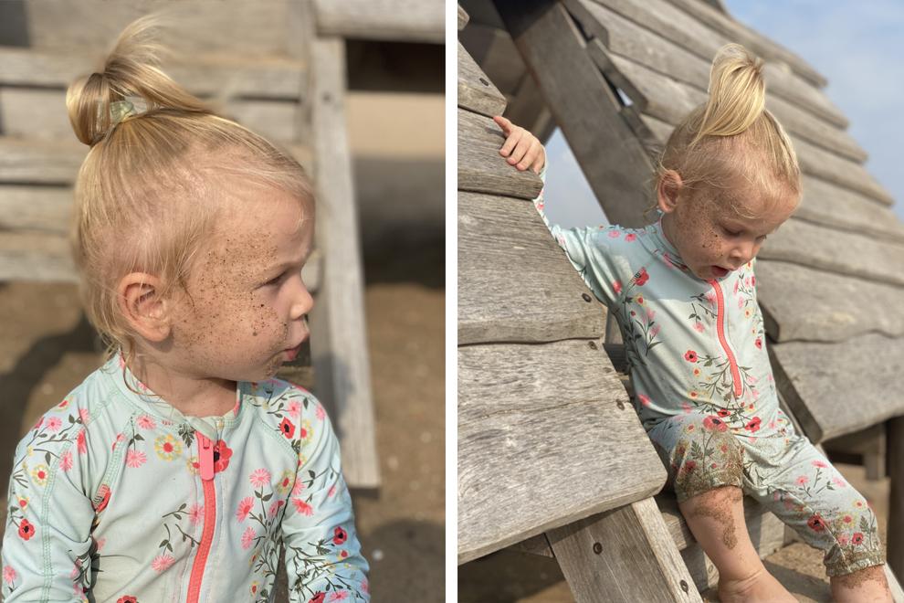 Kind draagt een UV-pakje van Hema op het strand