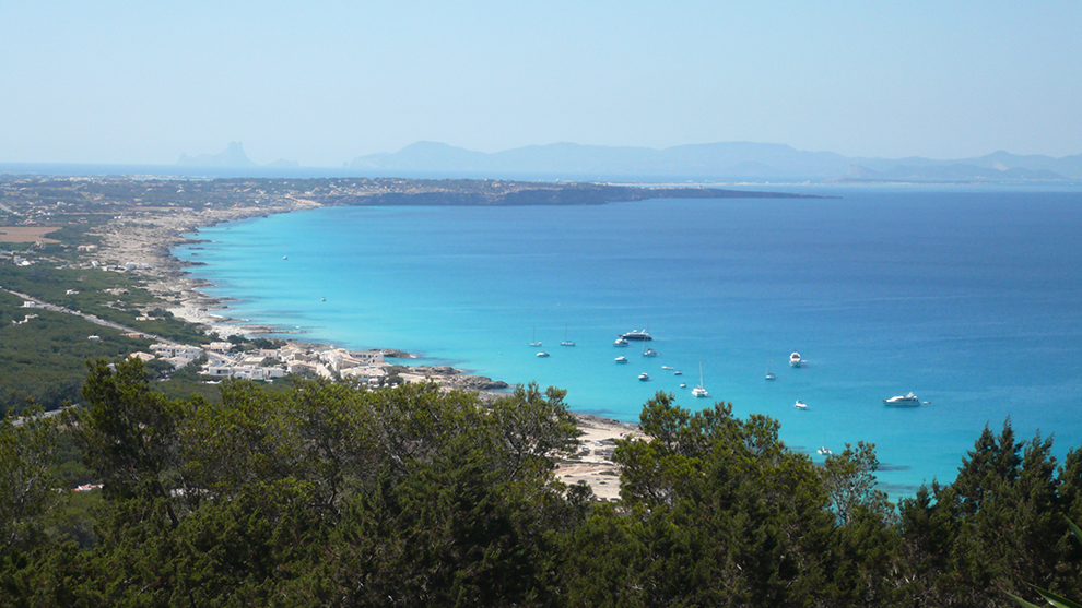 The bright blue waters of the Formentera coast