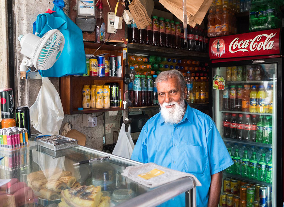 Local inhabitant of Mauritius in his little shop