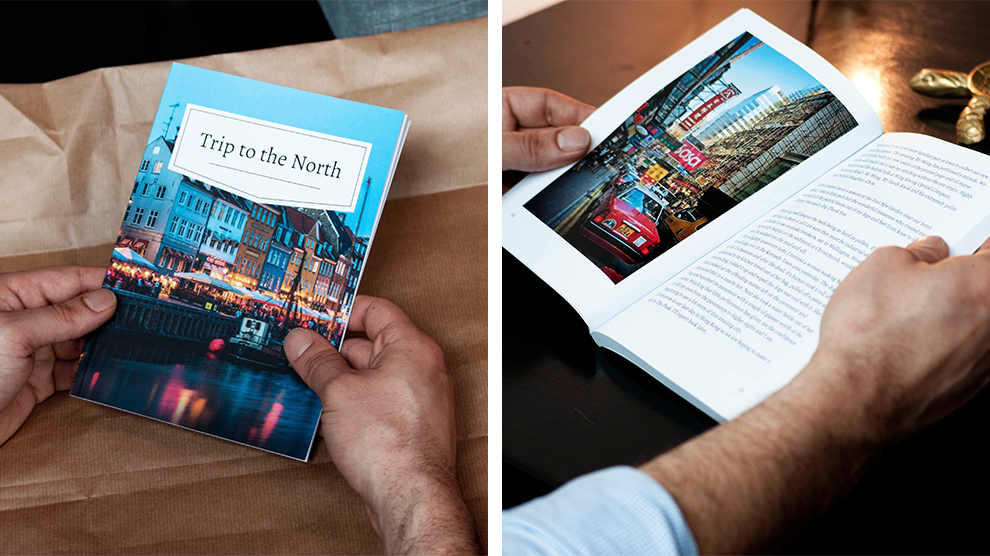 Printed softcover book in the hands of its new owner
