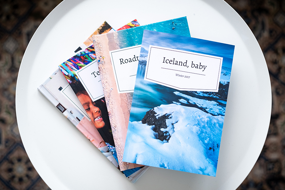 Pile of hardcover and softcover diaries with photo cover