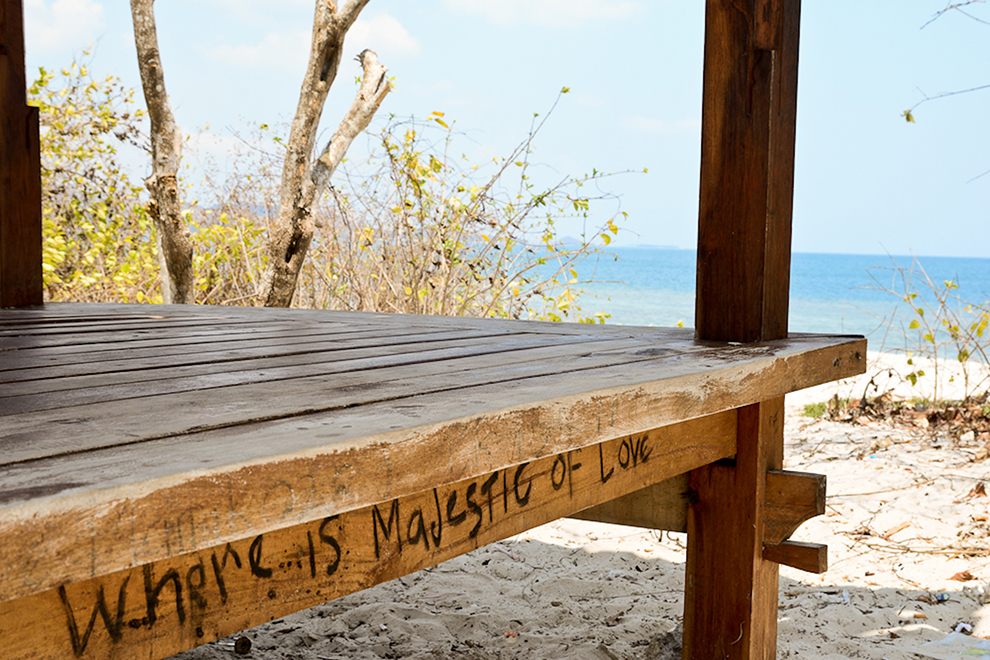 Wooden shed with the text 'where is majestic of love' on it
