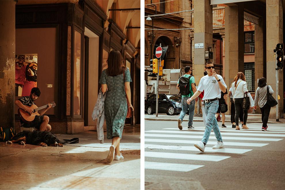 Stadsbeeld Bologna: mensen lopen rustig over straat